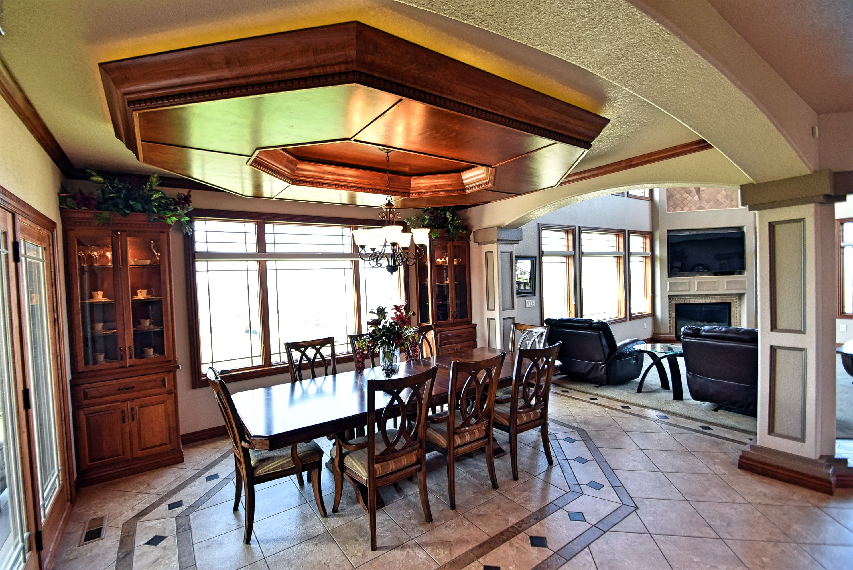 Dining room with cherry drop ceiling.