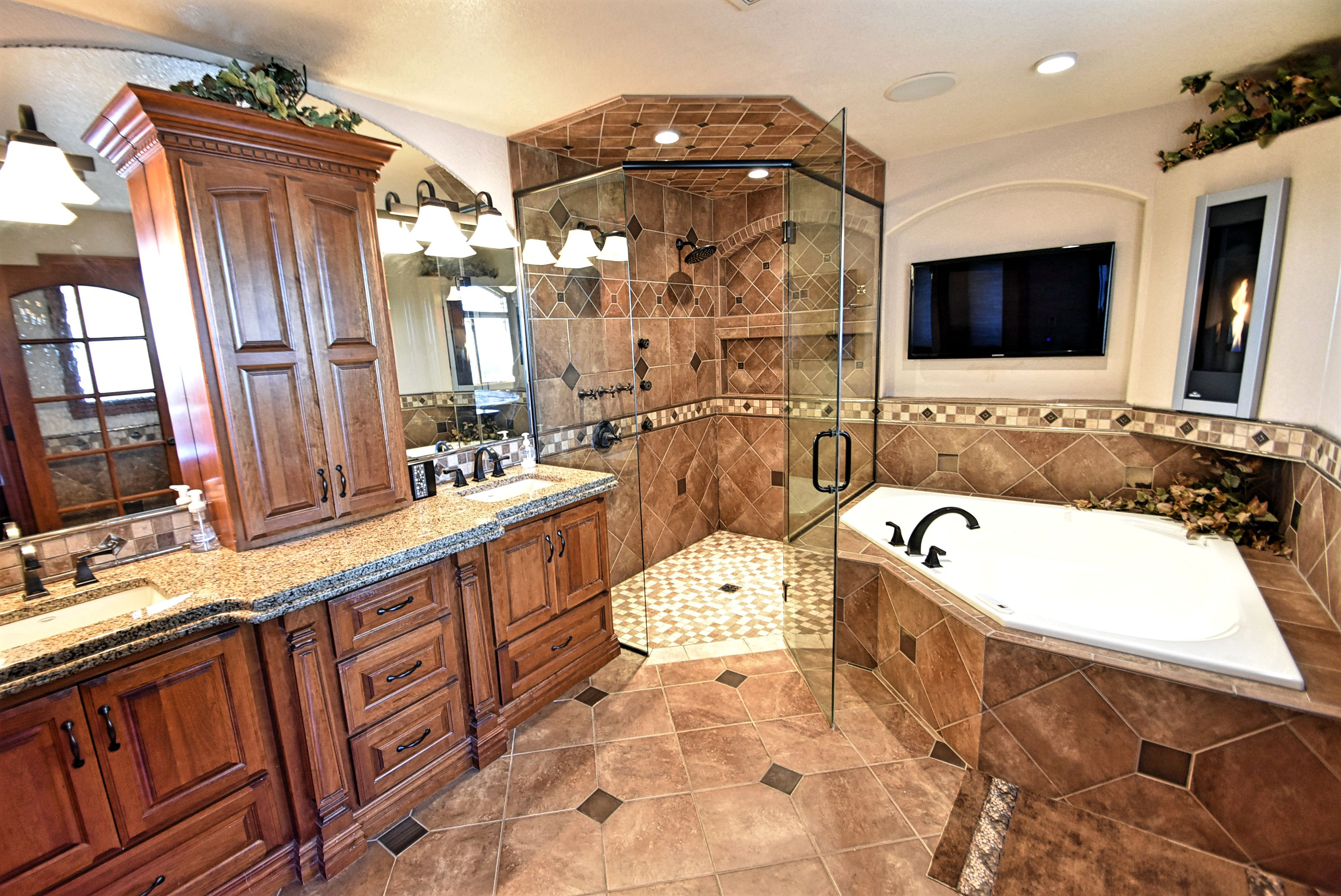 Master bath with curbless shower and fireplace.